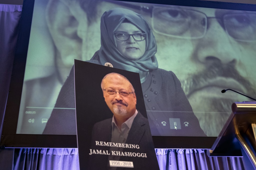 FILE - In this Nov. 2, 2018 file photo, a video image of Hatice Cengiz, fiancee of slain Saudi journalist Jamal Khashoggi, is played during an event t