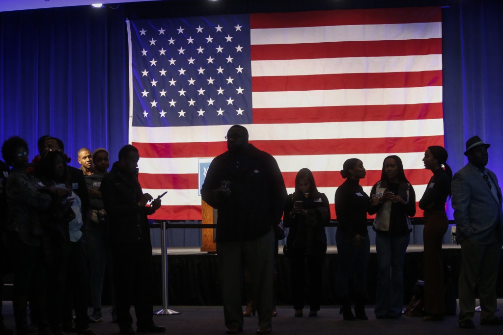Democrat Mike Espy's campaign supporters stand around waiting for election results in the auditorium at the Mississippi Civil Rights Museum in Jackson...
