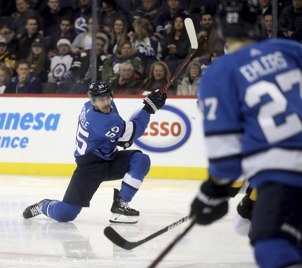 Winnipeg Jets' Mark Scheifele (55) scores against the Pittsburgh Penguins during the second period of an NHL hockey game, Tuesday, Nov. 27, 2018, in W