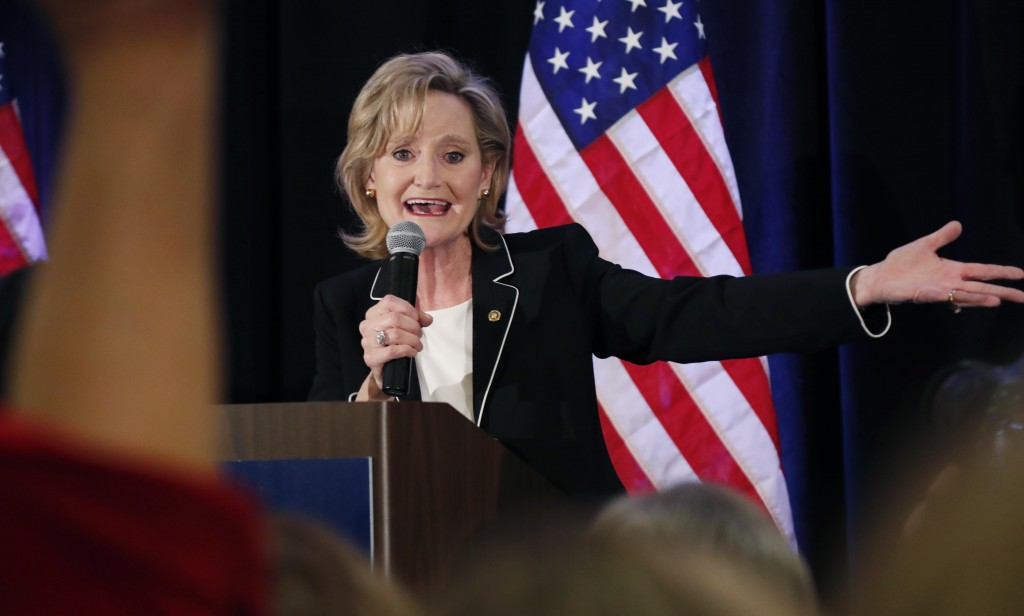 Republican U.S. Sen. Cindy Hyde-Smith calls on her family members to identify themselves as she celebrates her runoff win over Democrat Mike Espy in J...