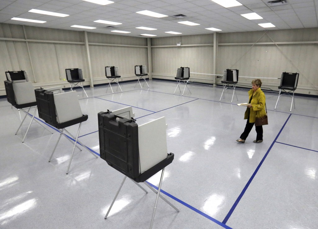 Kathleen McCann walks to cast her vote  in a runoff election Tuesday, Nov. 27, 2018 in Gulfport, Miss.  Mississippi voters are deciding the last U.S. ...