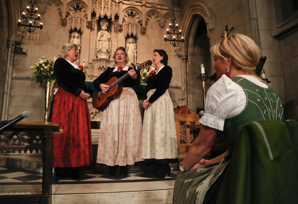 """The Kroell Family Singers, Gerlinde, left, Elisabeth, center, and Christiane, sing Christmas Carols during a celebration of the song """"Silent Night,"""" a"""