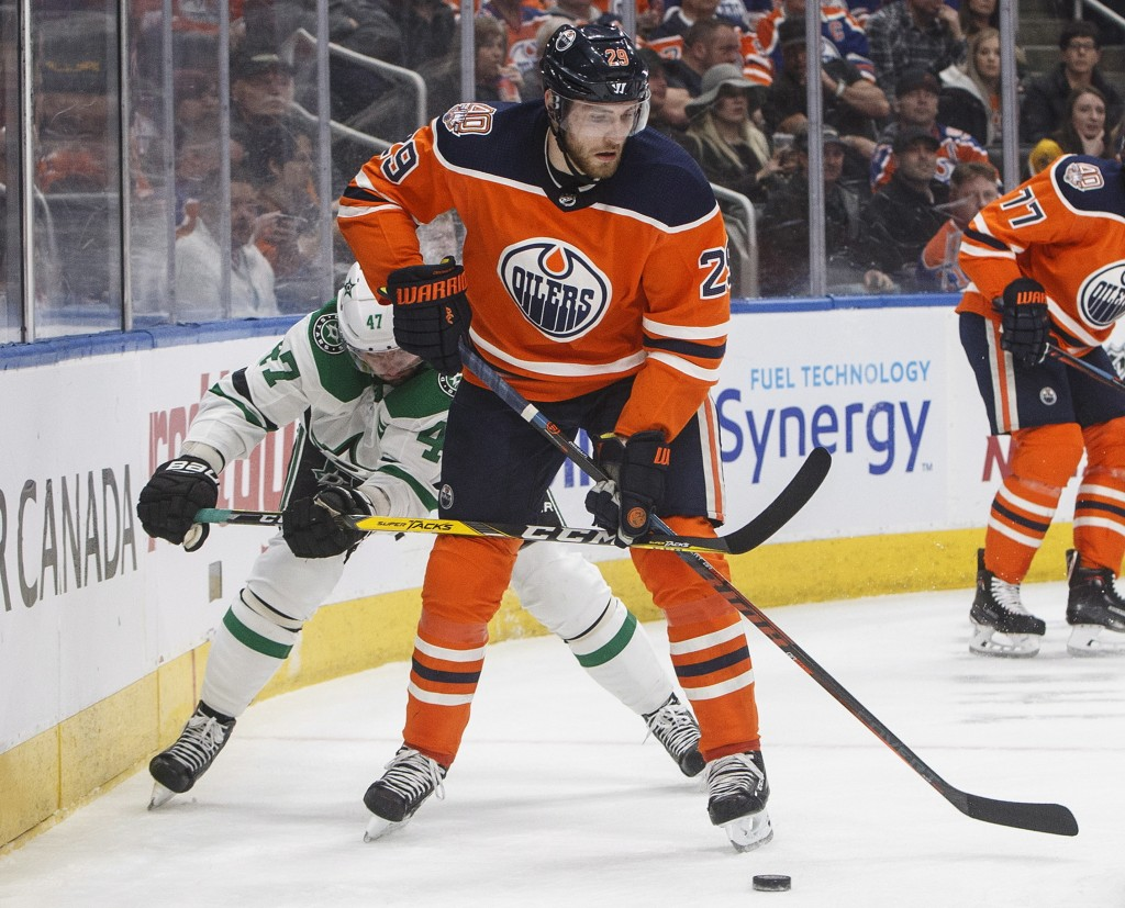 Dallas Stars' Alexander Radulov (47) chases Edmonton Oilers' Leon Draisaitl (29) during first period NHL hockey action in Edmonton, Alberta, on Tuesda