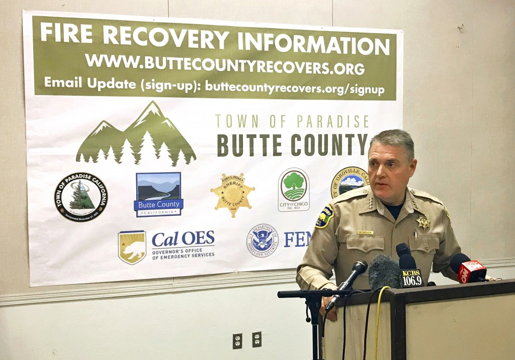 In this Nov. 21, 2018 photo, Butte County Sheriff Kory Honea updates the number of dead and structures destroyed in the massive Northern California Ca...