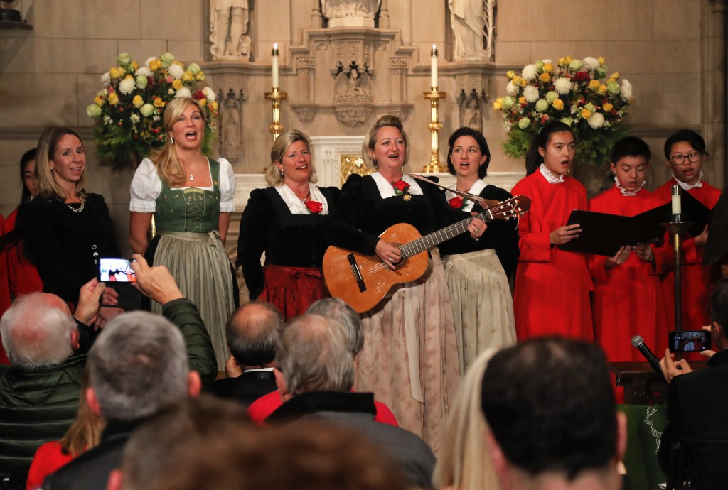 """The Kroell Family Singers, center, sing """"Silent Night"""" with the Choir of Trinity Wall Street and Trinity Youth Chorus during a celebration of the anni..."""