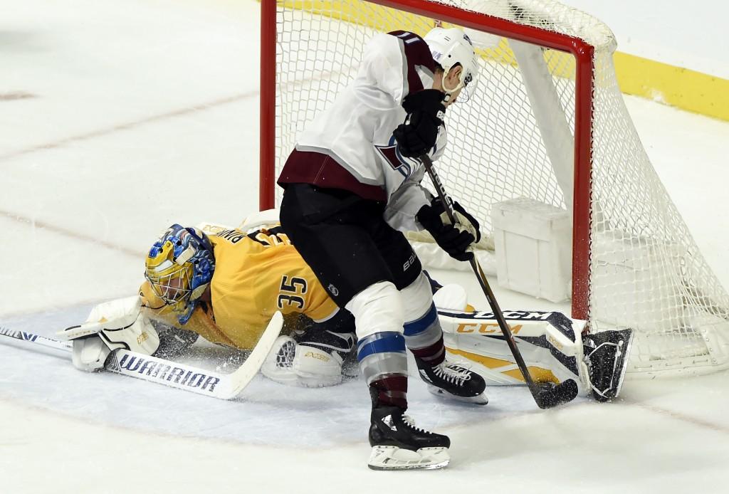 Nashville Predators goaltender Pekka Rinne (35), of Finland, blocks a shot by Colorado Avalanche left wing Matt Calvert (11) during the second period