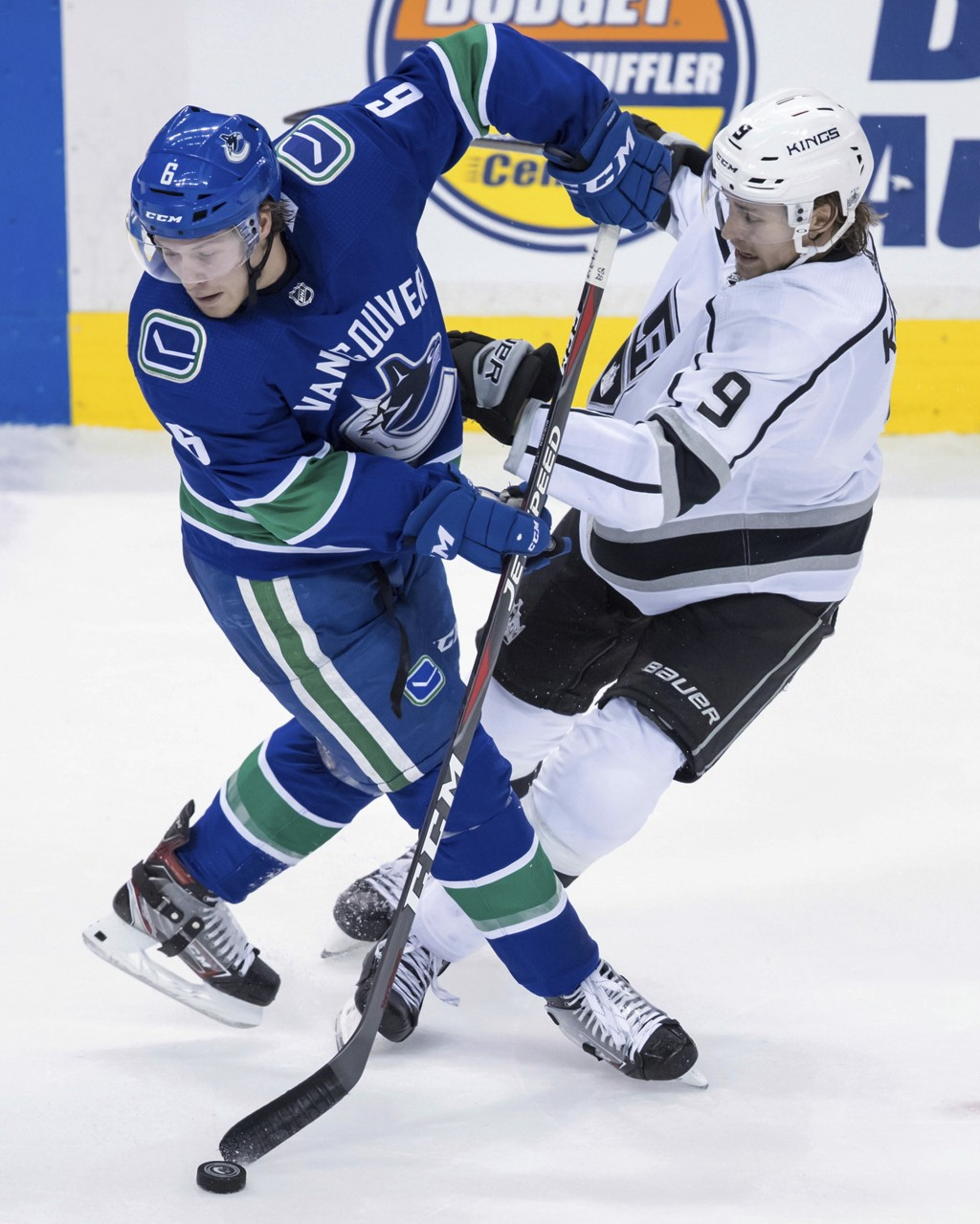 Vancouver Canucks' Brock Boeser, left, and Los Angeles Kings' Adrian Kempe, of Sweden, collide during the second period of an NHL hockey game Tuesday,...