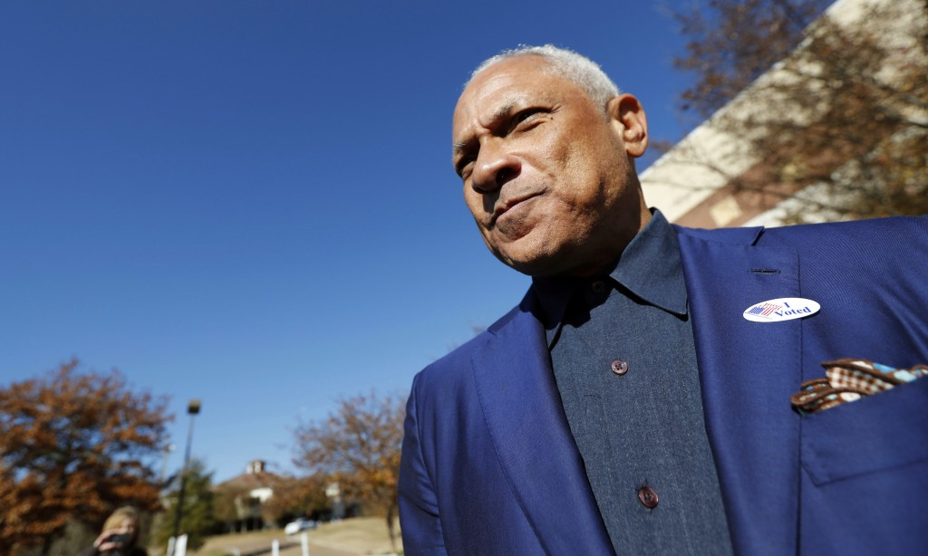 Democrat Mike Espy leaves his precinct after voting in a runoff election Tuesday, Nov. 27, 2018 in Ridgeland, Miss.  Mississippi voters are deciding t...