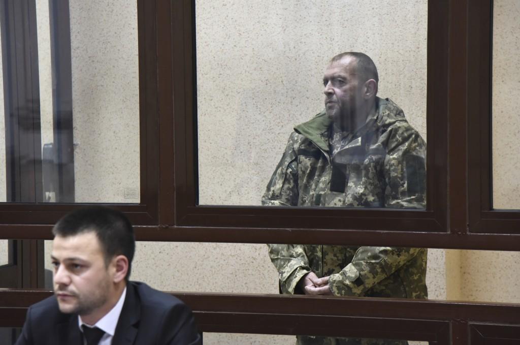 One of the captured Ukrainian sailors speaks in a court room in Simferopol, Crimea, Tuesday, Nov. 27, 2018. A Crimean court has ordered one of the Ukr...