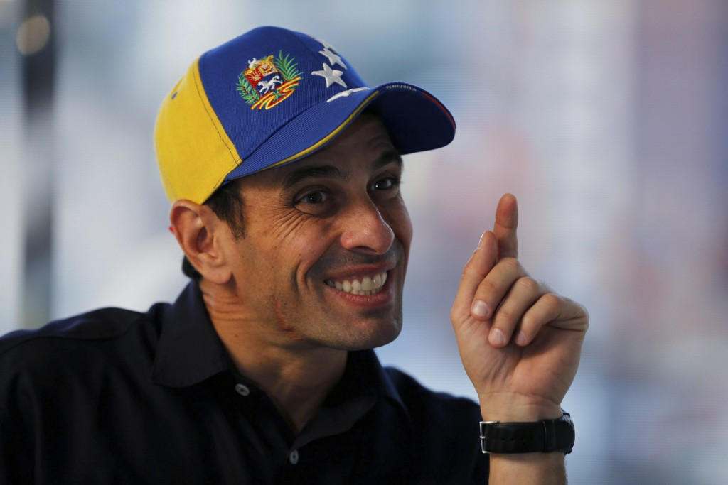 FILE - In this Feb. 25, 2014 file photo, opposition leader Henrique Capriles points during an interview at his office in Caracas, Venezuela. Capriles