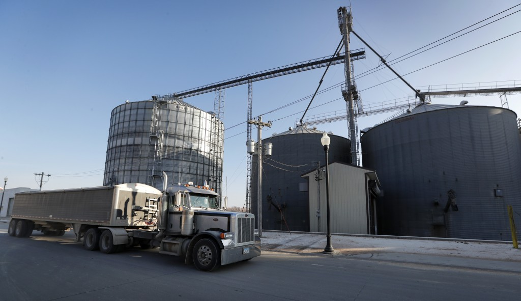 In this Nov. 21, 2018, photo, a truck pass the Brooklyn Elevator before unloading in Brooklyn, Iowa. Farmers still working to get out their remaining