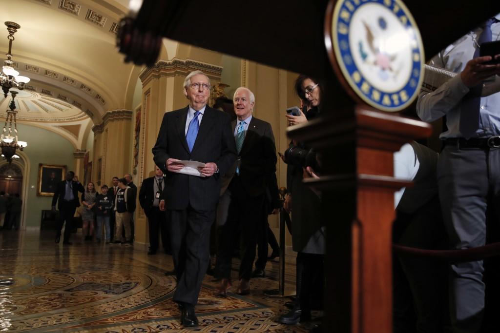 Senate Majority Leader Mitch McConnell of Ky., arrives with Senate Majority Whip Sen. John Cornyn, R-Texas, to speak to the media after a Republican p...
