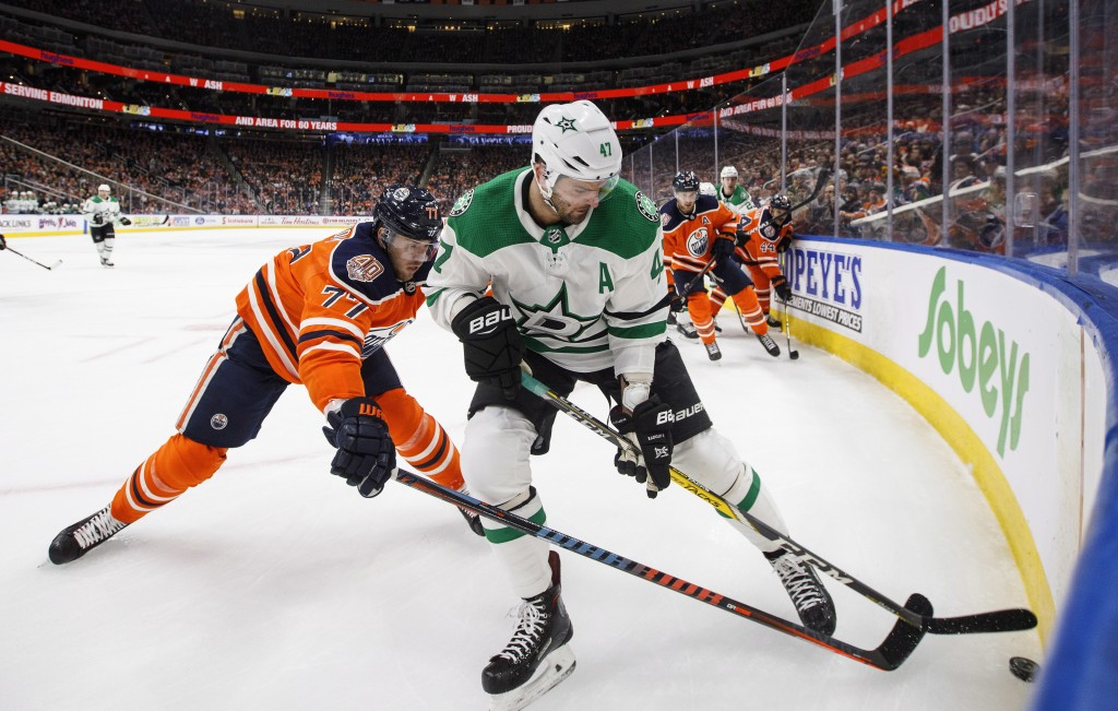 Dallas Stars' Alexander Radulov (47) and Edmonton Oilers' Oscar Klefbom (77) battle for the puck during first period NHL hockey action in Edmonton, Al...