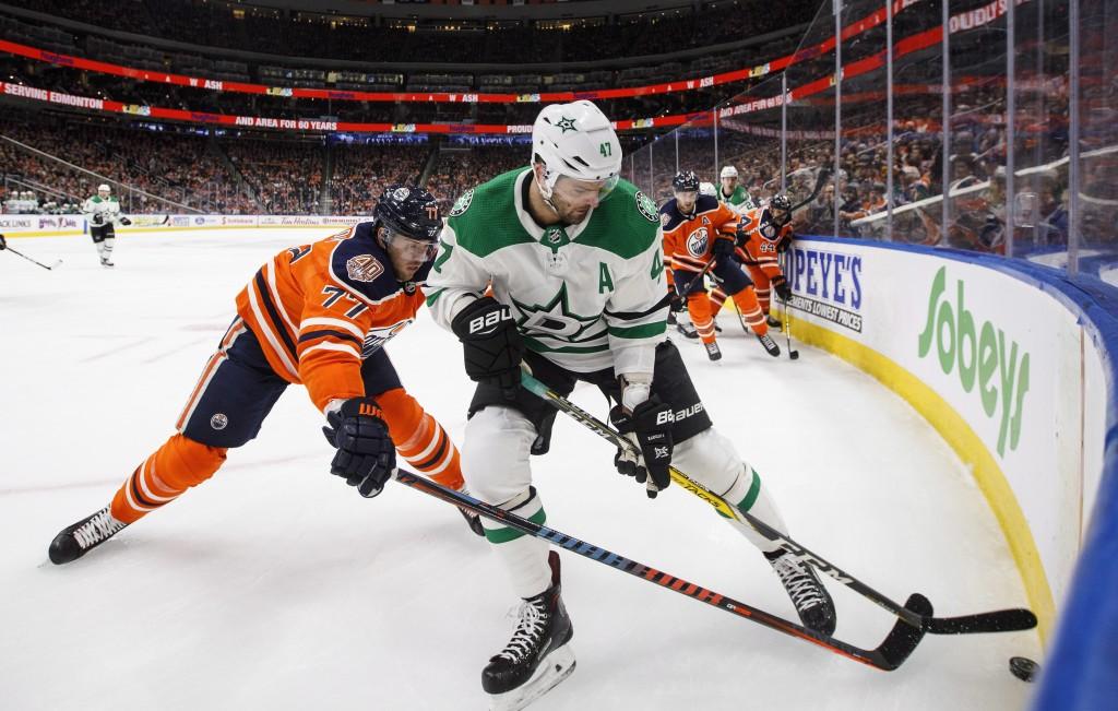 Dallas Stars' Alexander Radulov (47) and Edmonton Oilers' Oscar Klefbom (77) battle for the puck during first period NHL hockey action in Edmonton, Al