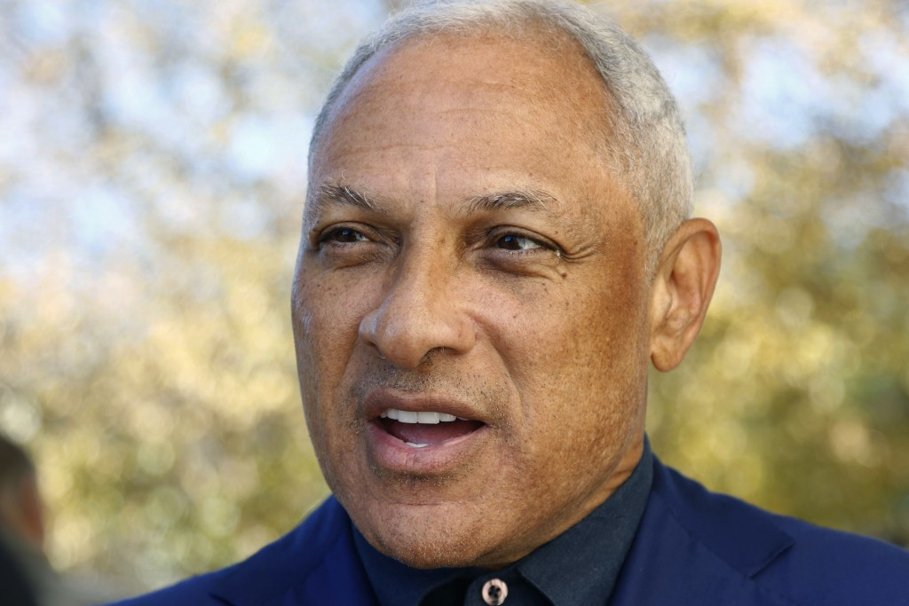 Democrat Mike Espy speaks with reporters after voting in a runoff election Tuesday, Nov. 27, 2018 in Ridgeland, Miss.  Mississippi voters are deciding...