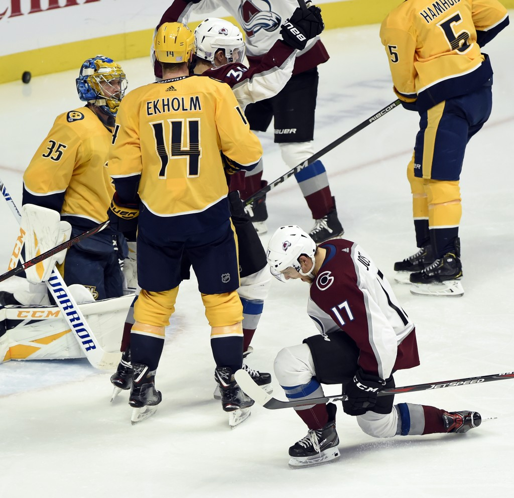 Colorado Avalanche center Tyson Jost (17) celebrates after scoring a goal against the Nashville Predators during the third period of an NHL hockey gam...