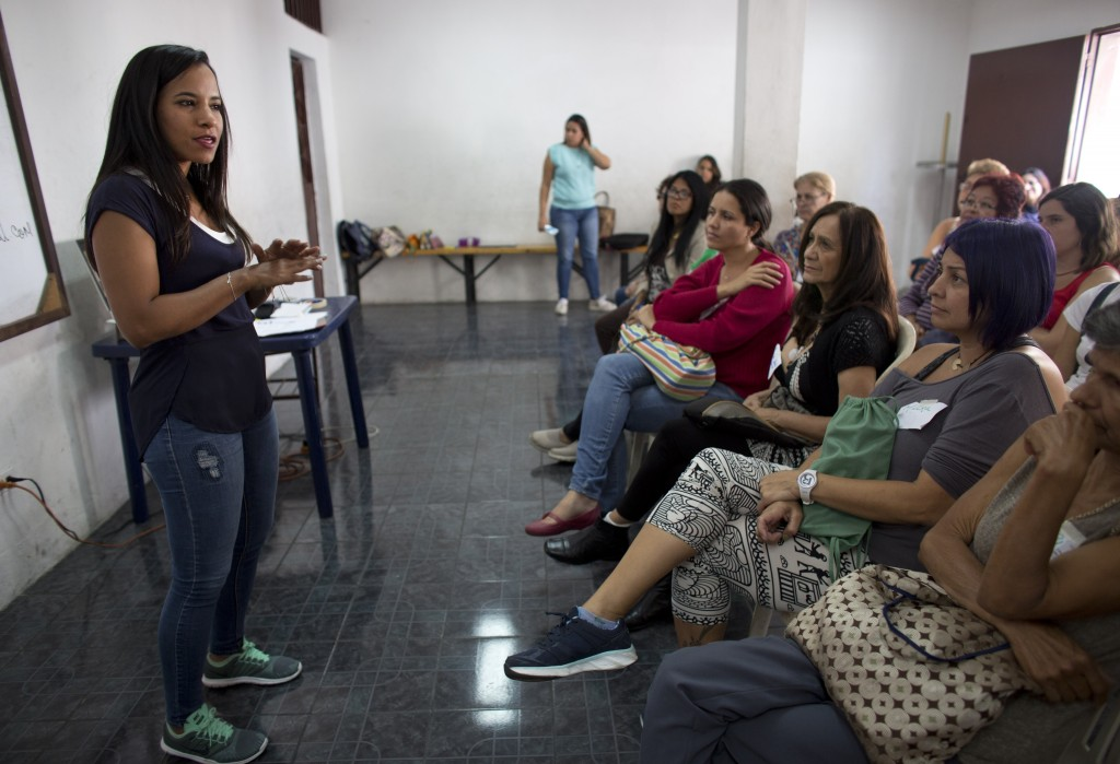 In this Aug. 26, 2018 photo, Marialbert Barrios speaks to a group of women at an empowerment workshop, in the Catia neighborhood of Caracas, Venezuela...