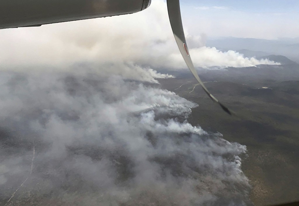 In this undated photo released by the Queensland Fire and Emergency Service fires burn north of Bundaberg, Australia. Hundreds of firefighters are pre...