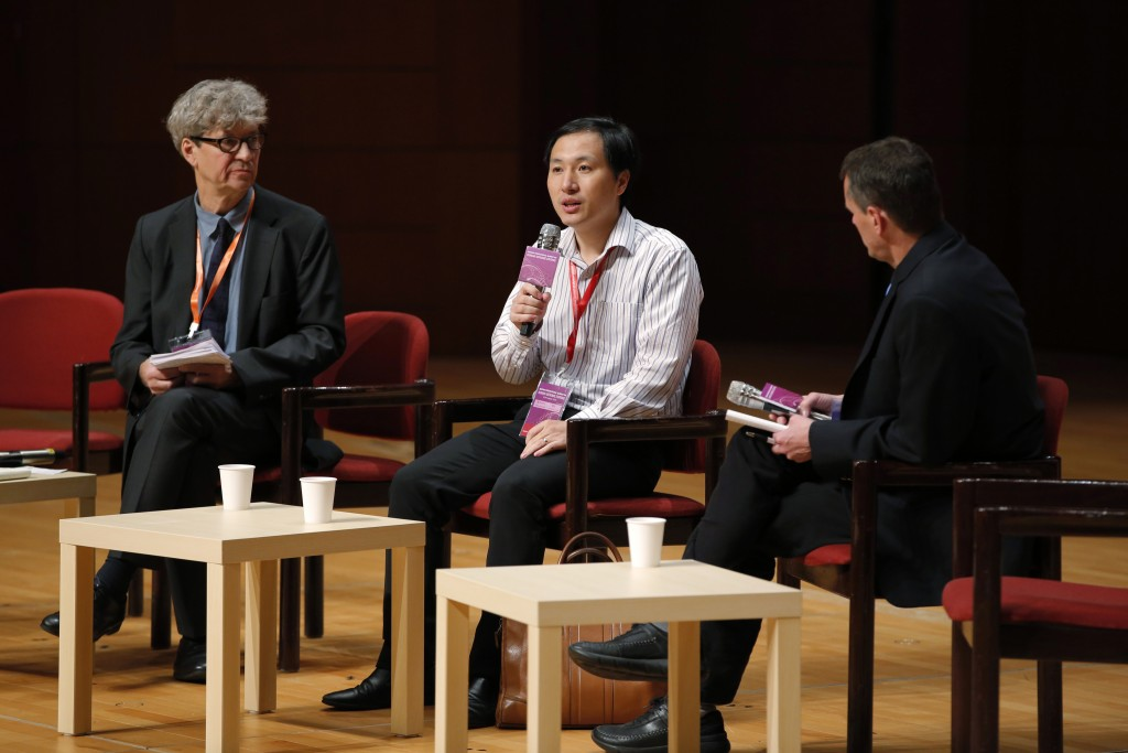 He Jiankui, a Chinese researcher, center, speaks during the Human Genome Editing Conference in Hong Kong, Wednesday, Nov. 28, 2018. He made his first ...