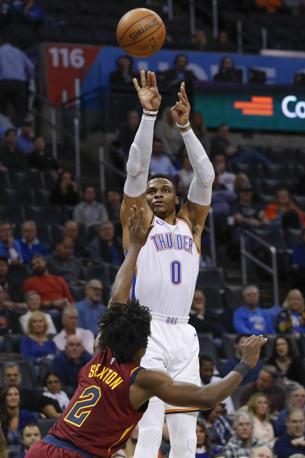 Oklahoma City Thunder guard Russell Westbrook (0) shoots over Cleveland Cavaliers guard Collin Sexton (2) during the second half of an NBA basketball ...