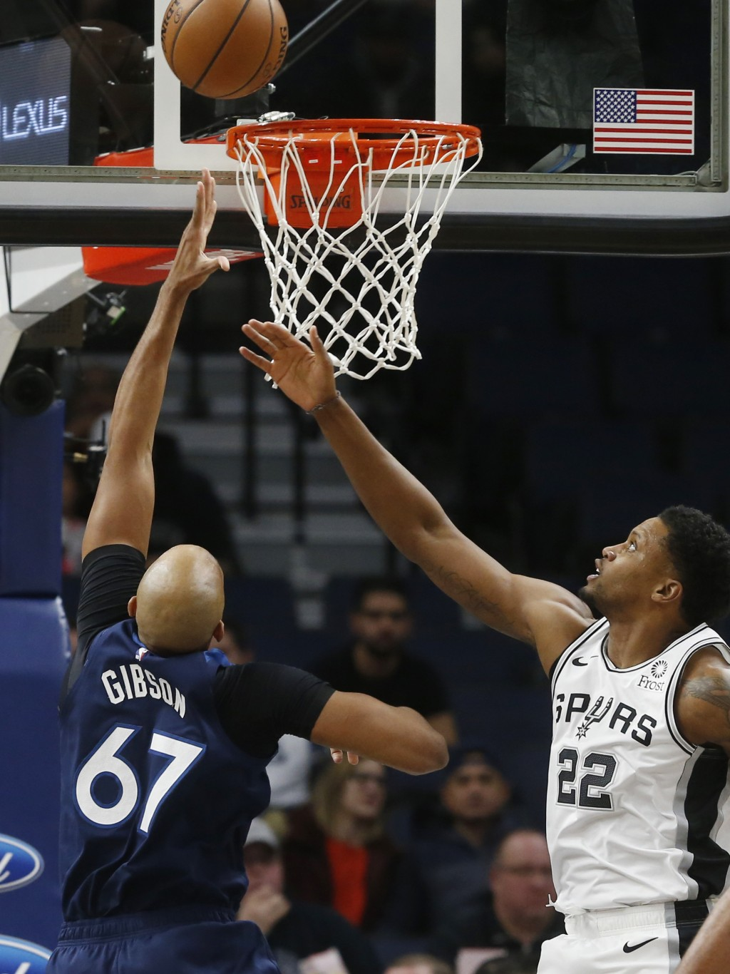 Minnesota Timberwolves' Taj Gibson, left, lays up as San Antonio Spurs' Rudy Gay watches in the first half of an NBA basketball game Wednesday, Nov. 2...