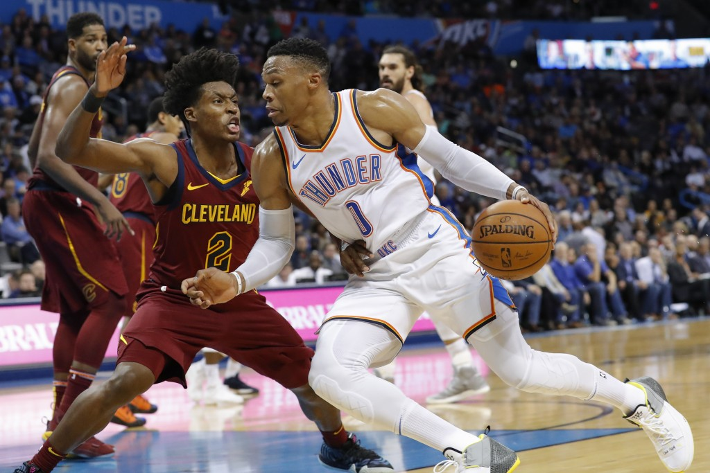 Oklahoma City Thunder guard Russell Westbrook (0) drives to the basket around Cleveland Cavaliers guard Collin Sexton (2) during the second half of an...