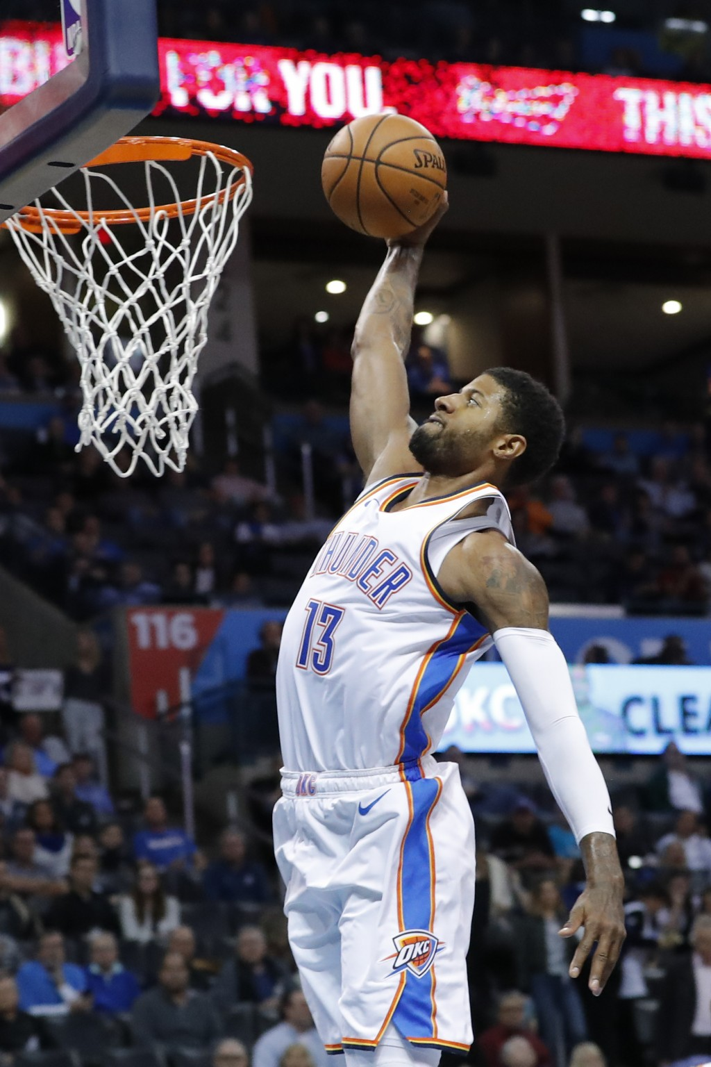 Oklahoma City Thunder forward Paul George dunks against the Cleveland Cavaliers during the second half of an NBA basketball game in Oklahoma City, Wed...