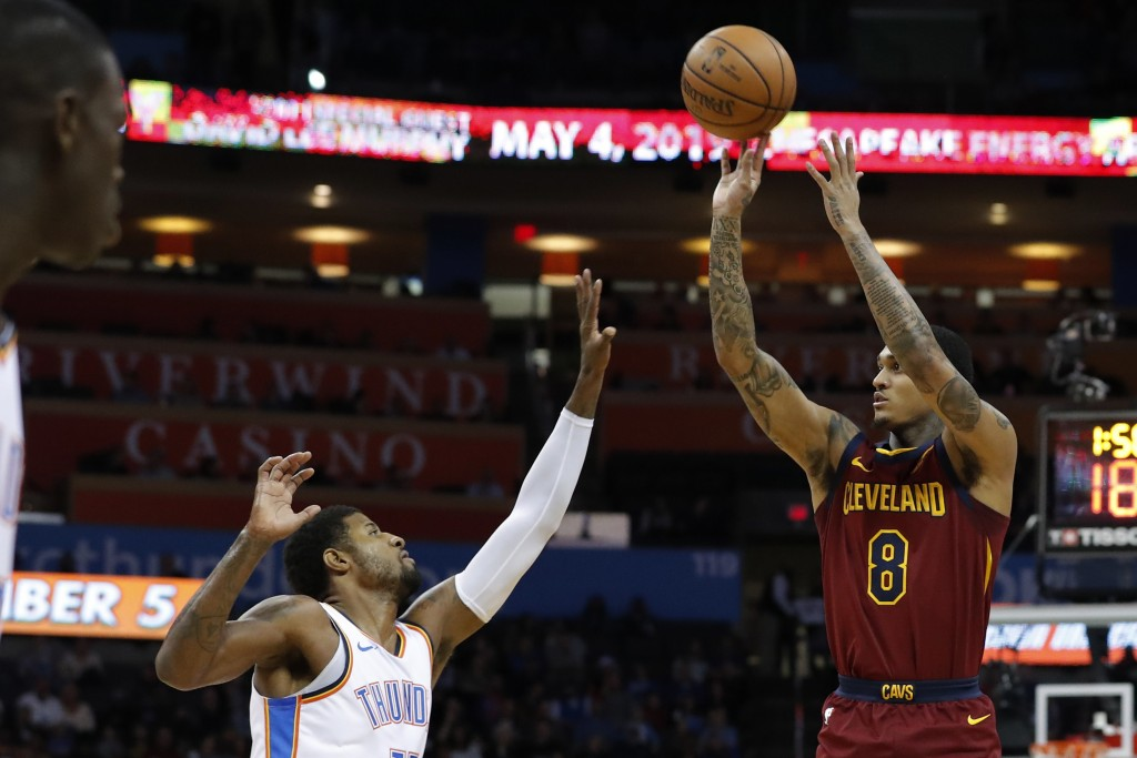 Cleveland Cavaliers guard Jordan Clarkson (8) shoots over Oklahoma City Thunder forward Paul George during the first half of an NBA basketball game in...