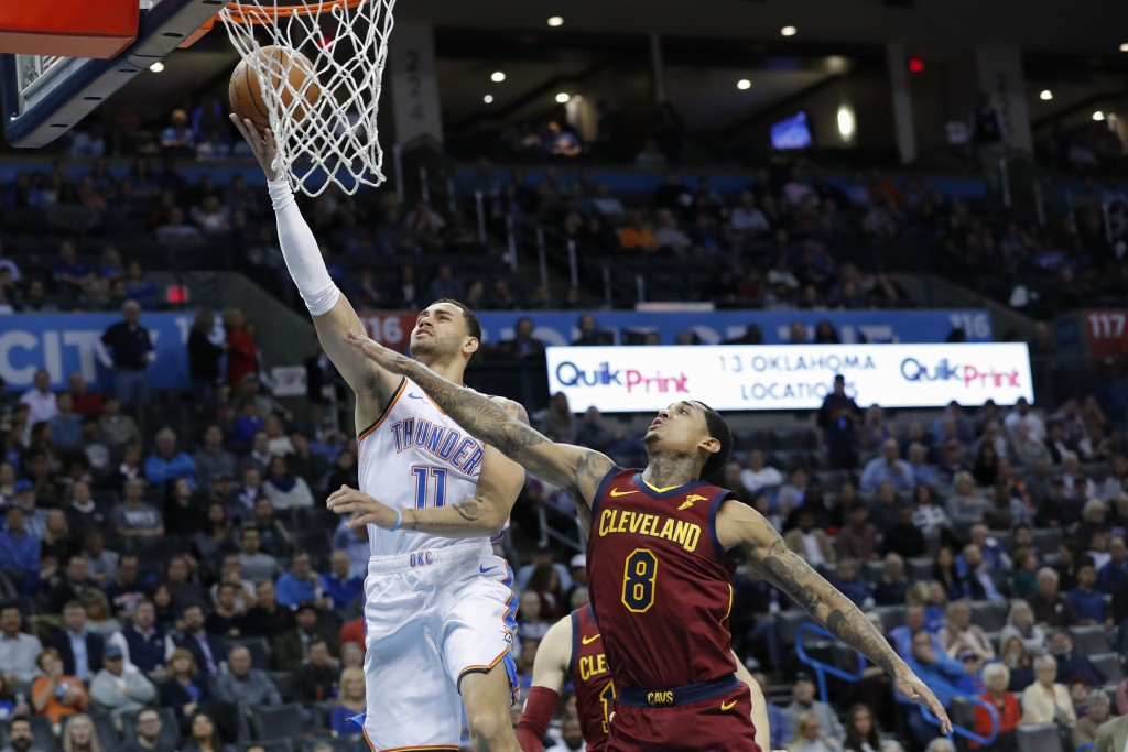 Oklahoma City Thunder forward Abdel Nader (11) goes up for a basket ahead of Cleveland Cavaliers guard Jordan Clarkson (8) during the second half of a...