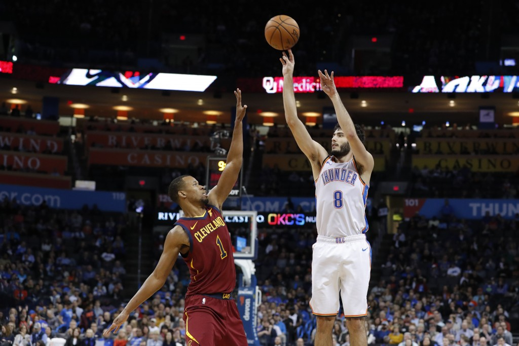 Oklahoma City Thunder guard Alex Abrines (8) shoots over Cleveland Cavaliers guard Rodney Hood (1) during the second half of an NBA basketball game in...