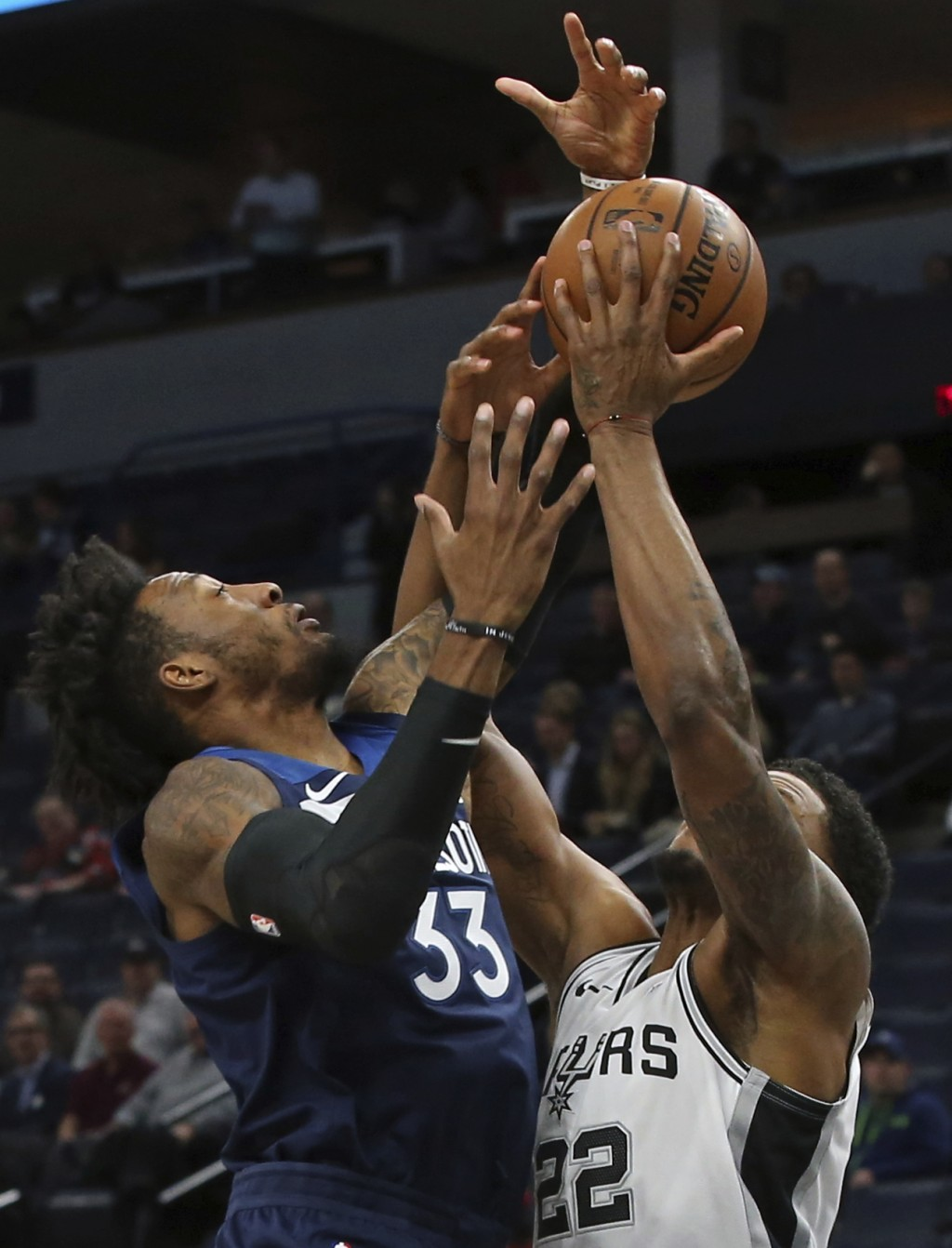 San Antonio Spurs' Rudy Gay, right, tries to control the ball as Minnesota Timberwolves' Robert Covington defends in the first half of an NBA basketba...
