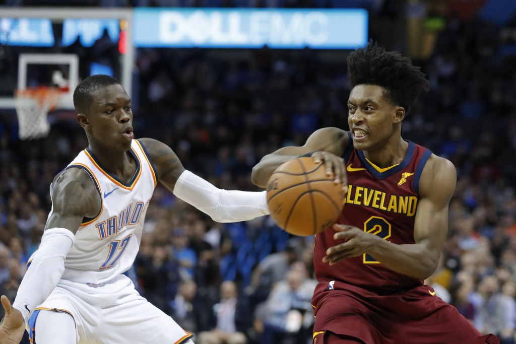 Cleveland Cavaliers guard Collin Sexton (2) passes the ball around Oklahoma City Thunder guard Dennis Schroeder (17) during the first half of an NBA b...