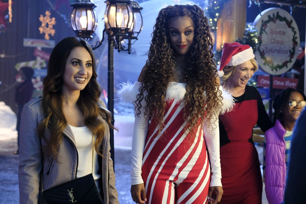 """This image released by Freeform shows Francia Raisa, left, and Tyra Banks in a scene from """"Life-Siz 2: A Christmas Eve,"""" airing on Sunday, Dec. 2, at ..."""