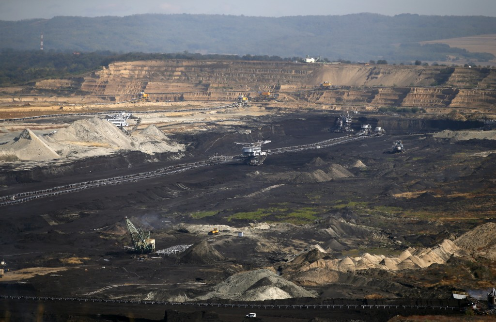 In this photo taken Wednesday, Oct. 3, 2018, mining machines work in the open cast mine near Kostolac, Serbia. Chinese companies are currently involve...
