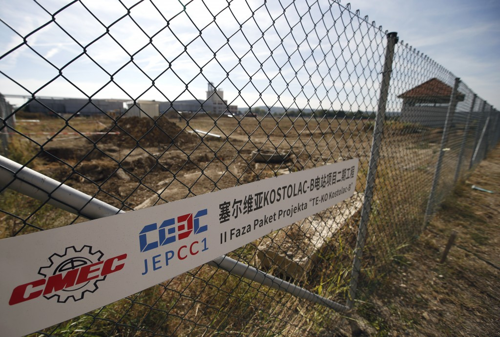 """In this photo taken Wednesday, Oct. 3, 2018, a sign of the new, so-called """"Kostolac Bloc 3"""" at the fence of Serbia's main coal-fired power station nea..."""