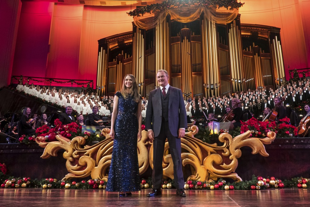 """This image released by PBS shows actors Sutton Foster, foreground left, and Hugh Bonneville, in """"Christmas with the Mormon Tabernacle Choir Featuring ..."""