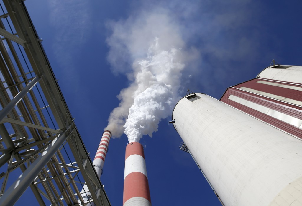 In this photo taken Wednesday, Oct. 3, 2018, smoke rises from the chimneys of Serbia's main coal-fired power station near Kostolac, Serbia. The Kostol...