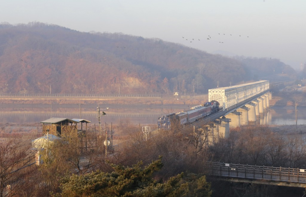 A South Korean train runs on the rail track which the two Koreas hope to eventually use as an international transport link near to the border villag