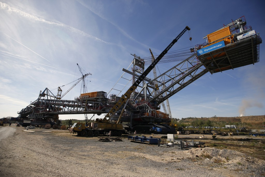 In this photo taken Wednesday, Oct. 3, 2018, a new lignite excavator stands in the open cast mine near Kostolac, Serbia. The Kostolac power plant comp...