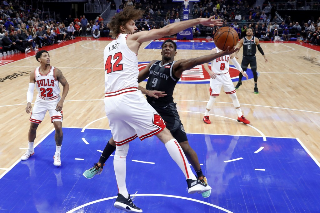 Detroit Pistons guard Langston Galloway (9) drives on Chicago Bulls center Robin Lopez (42) during the first half of an NBA basketball game in Detroit