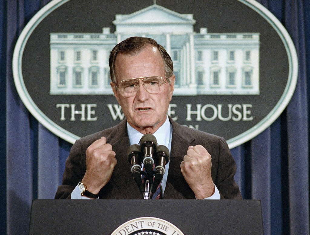 FILE - In this June 5, 1989 file photo, U.S. President George H.W. Bush holds a news conference at the White House in Washington where he condemned th
