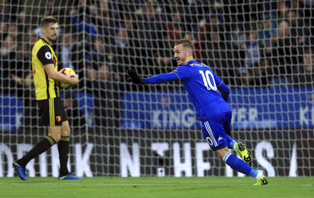 Leicester City's James Maddison right celebrates scoring his side's second goal of the during the English Premier League soccer match between Leice