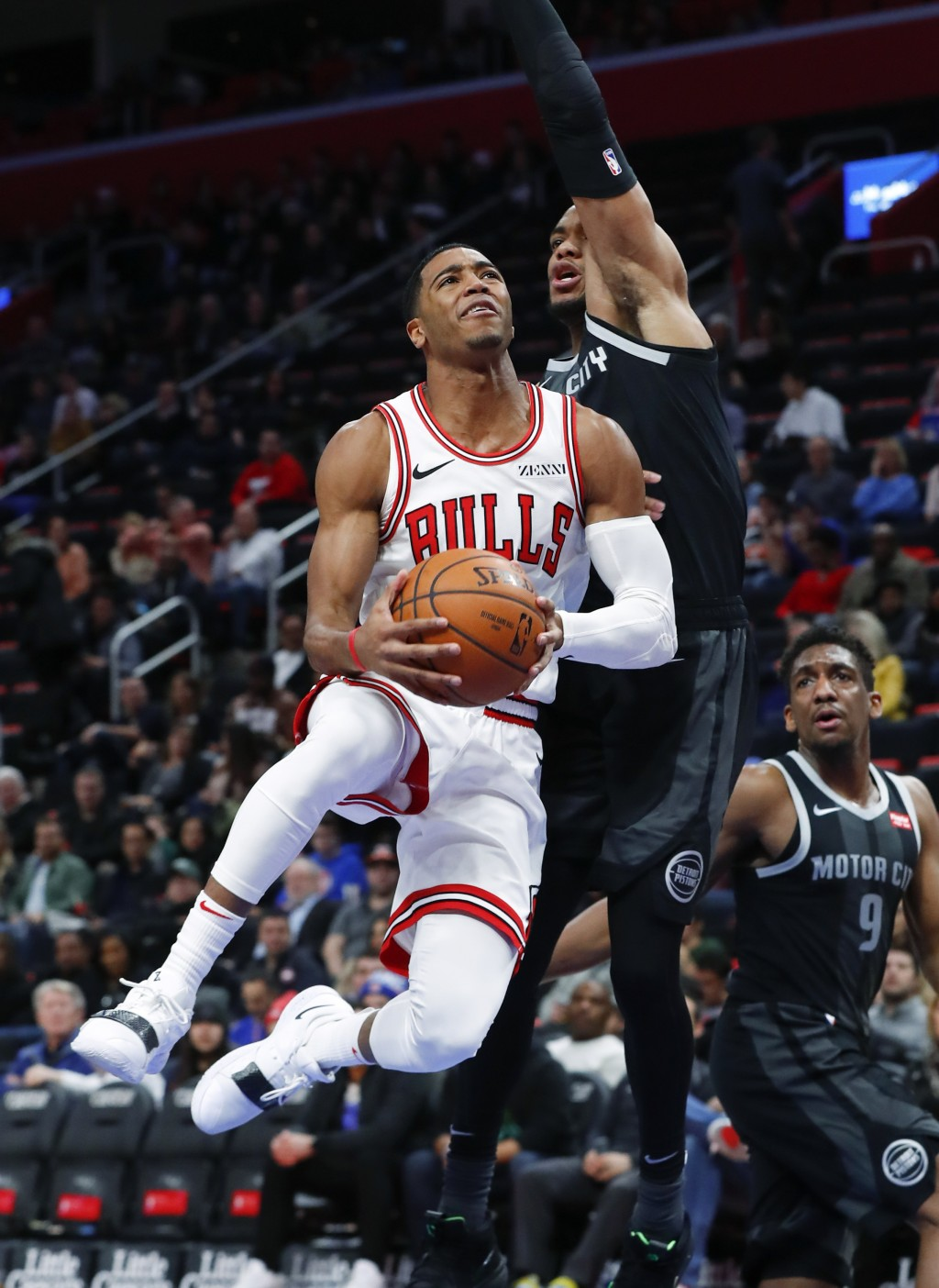 Chicago Bulls guard Shaquille Harrison (3) drives on Detroit Pistons guard Bruce Brown during the first half of an NBA basketball game in Detroit, Fri