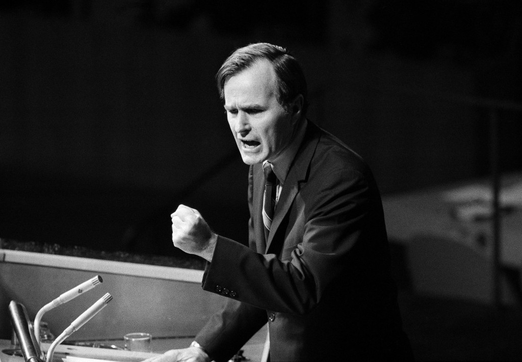 FILE - In this Oct. 18, 1971, file photo, U.S. Ambassador George H.W. Bush gestures as he addresses the United Nations General Assembly during the Chi