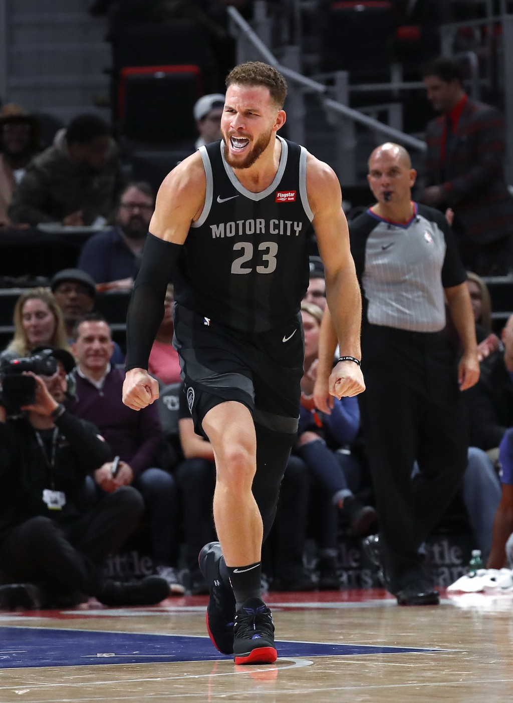 Detroit Pistons forward Blake Griffin reacts after hitting a basket against the Chicago Bulls in the first half of an NBA basketball game in Detroit,