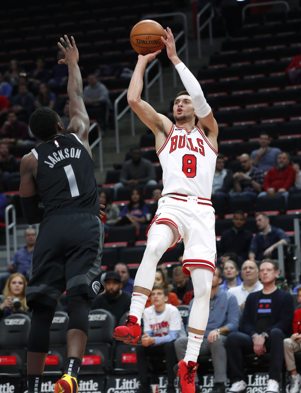 Chicago Bulls guard Zach LaVine (8) shoots as Detroit Pistons guard Reggie Jackson (1) defends during the first half of an NBA basketball game in Detr