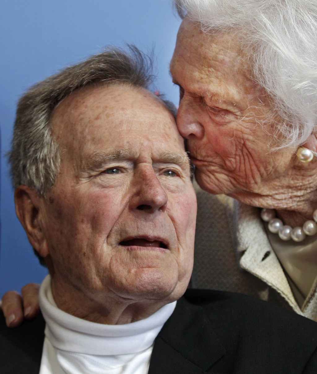 FILE - In this June 12, 2012 file photo, former President George H.W. Bush, and his wife, former first lady Barbara Bush, arrive for the premiere of H