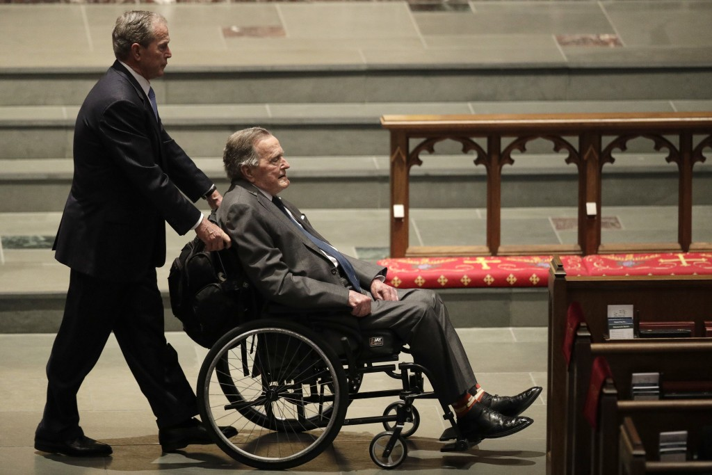 FILE - In this April 21, 2018 file photo, former Presidents George W. Bush, left, and George H.W. Bush arrive at St. Martin's Episcopal Church for a f