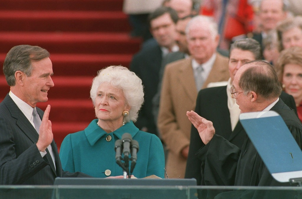 FILE - In this Jan. 20, 1989, file photo, President George H.W. Bush raises his right hand as he is sworn into office as the 41st president of the Uni