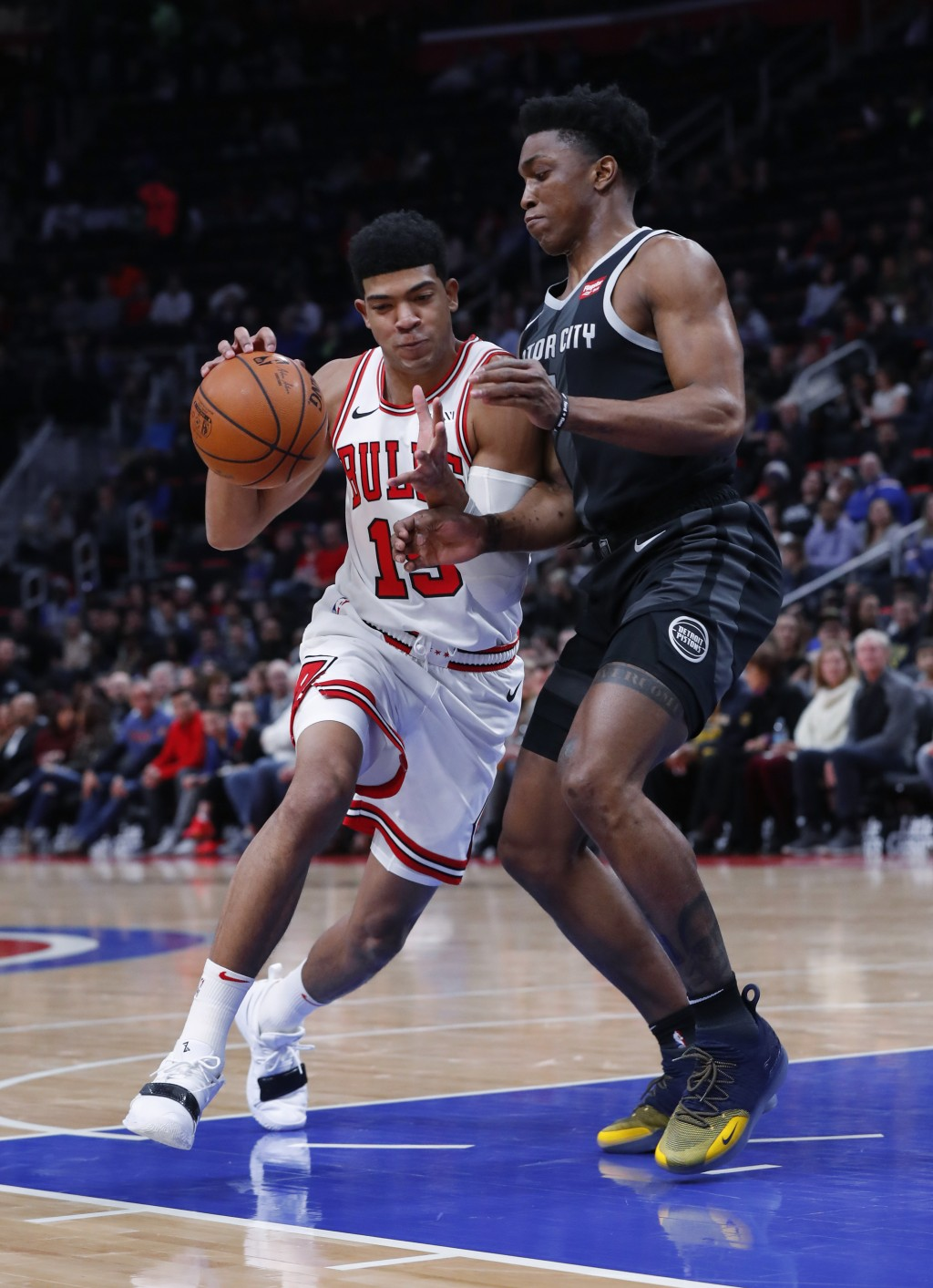 Chicago Bulls forward Chandler Hutchison (15) drives on Detroit Pistons forward Stanley Johnson during the first half of an NBA basketball game in Det